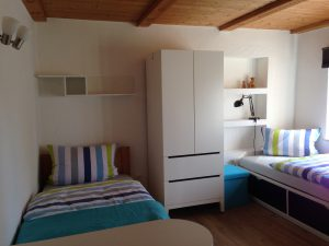 Double room 1 located on the 1st floor of the Morgnersacherl showing one bed and the wardrobe