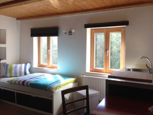 Double room 1 located on the 1st floor of the Morgnersacherl showing one bed and the windows